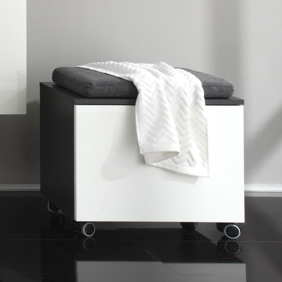 Simple White Storage Bench With 2 White Lined Baskets And Rattan Seats In A