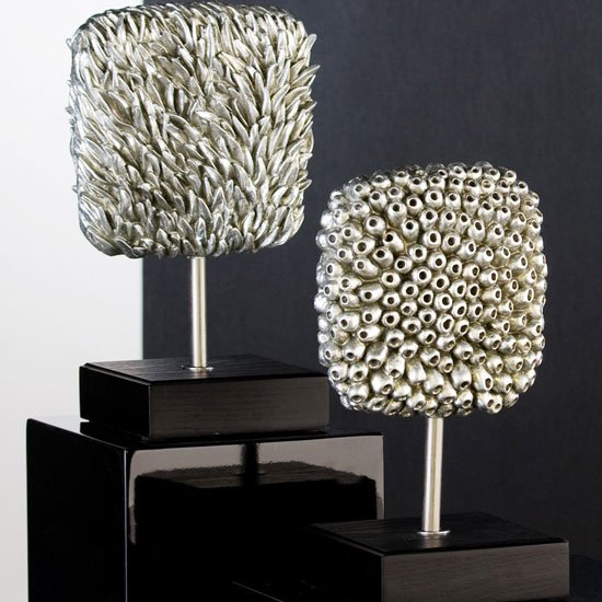 Read more about Grande sculpture in antique silver with wooden base