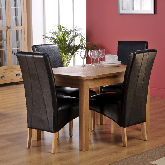 Corrick Dining Table With 4 Black Faux Leather Dining Chairs
