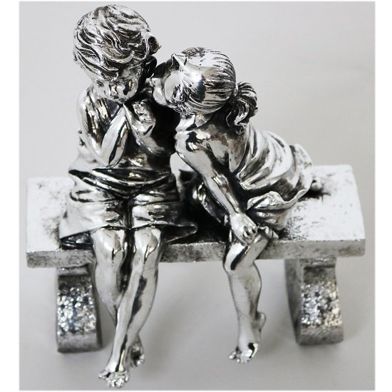 Boy and Girl Sitting on Bench Sculpture