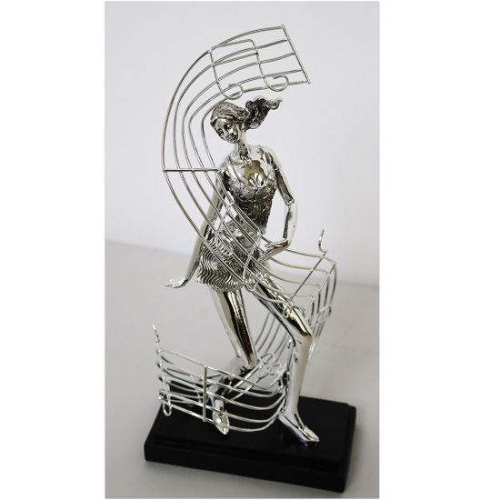 Female Dancer With Musical Note Sculpture