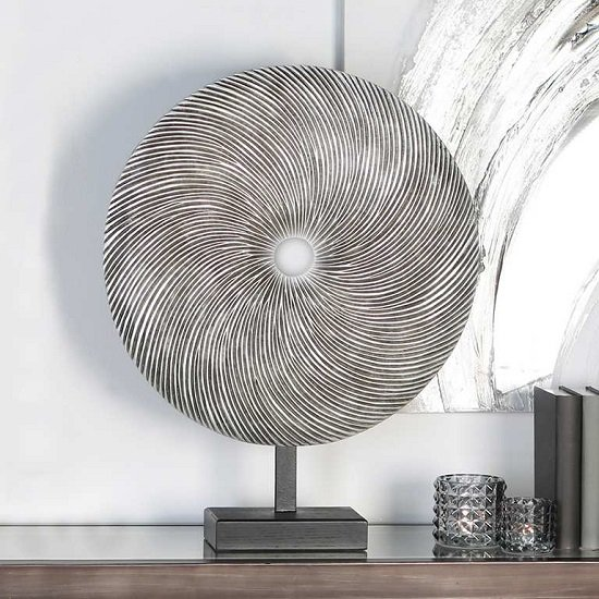 Read more about Wheel wood sculpture in silver metal on black base