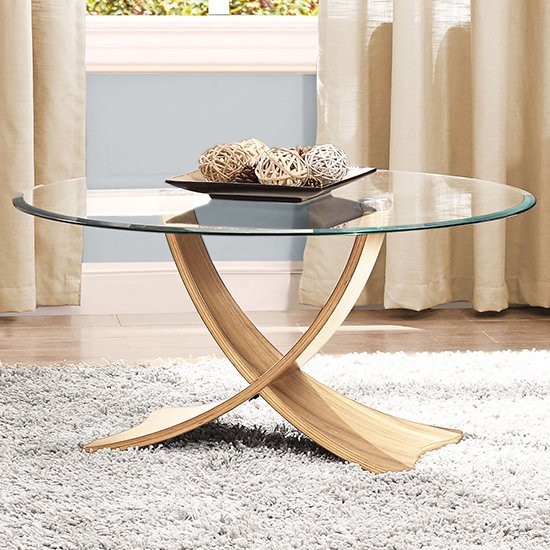 View Anfossi round clear glass coffee table with oak legs