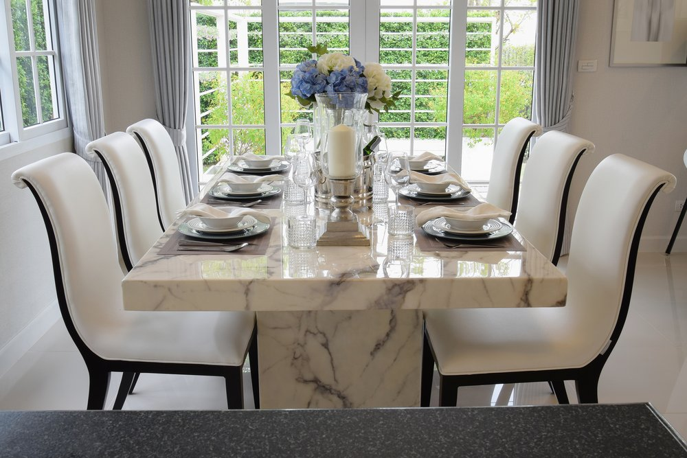 Savour Viands on designer dining table and chairs