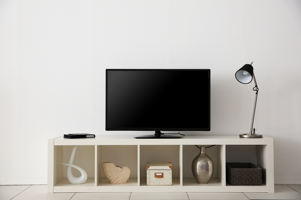 Buy a TV stand with chrome accent to add a contemporary touch to your house