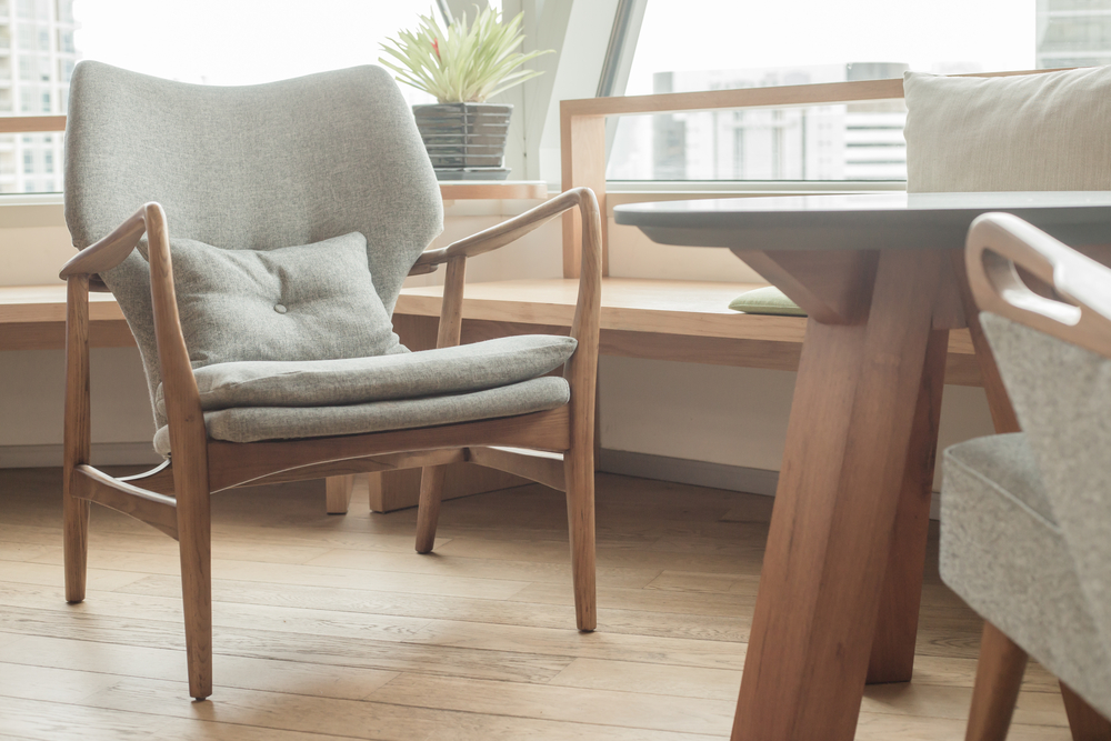 Decorate your home by incorporating living room chair with wooden arms