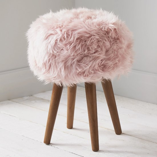 View Bovril sheepskin stool in blush pink with solid oak legs