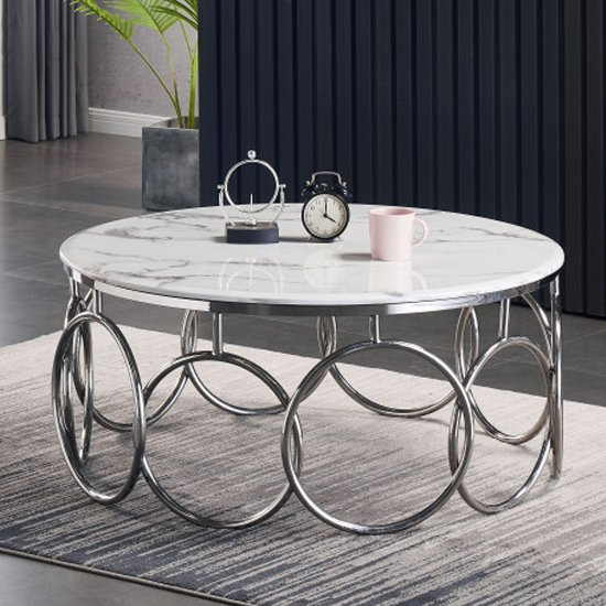 View Bruno white marble coffee table with silver stainless steel legs