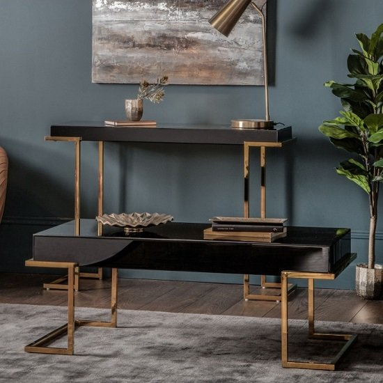 View Canela mirrored coffee table in black with gold metal legs