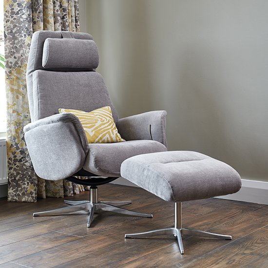 View Chalfont fabric swivel recliner chair with footstool in stone