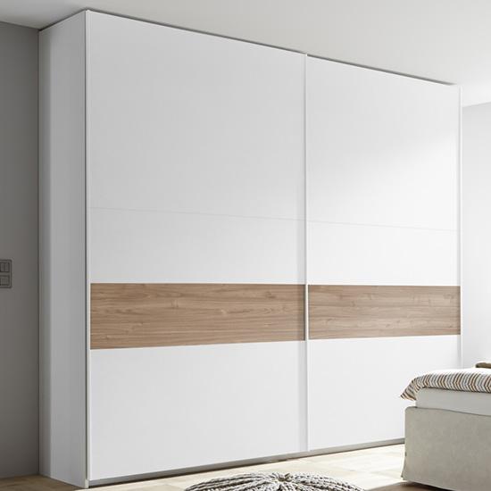 View Civico tall slide door wardrobe in matt white and stelvio walnut