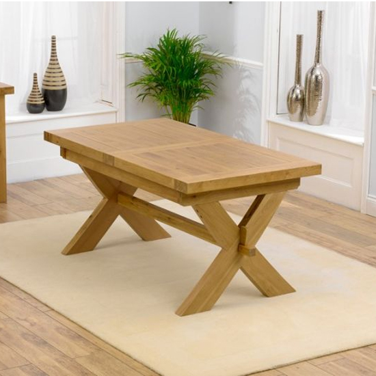 View Corlitta extending solid oak waxed dining table