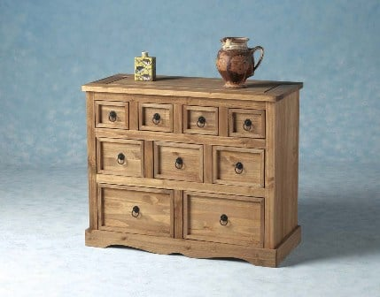 Carona 9 Drawers Chest In Distressed Waxed Pine