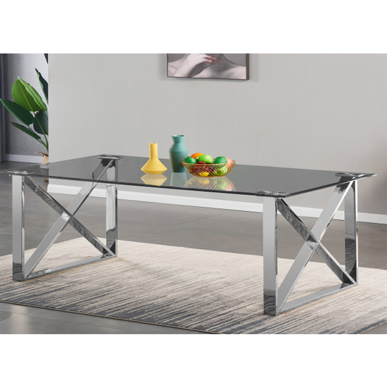 View Costa large glass dining table with silver stainless steel legs