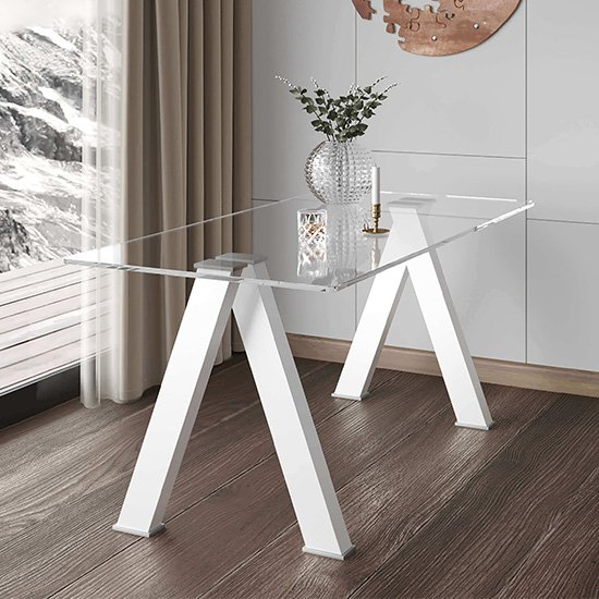 View Criss cross clear glass dining table with white wooden legs