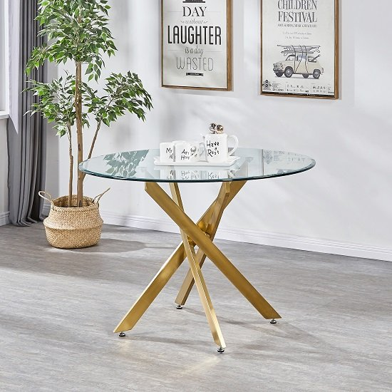 View Daytona round clear glass dining table with brushed gold legs