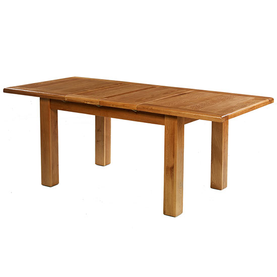 View Earls wooden medium extending dining table in chunky solid oak
