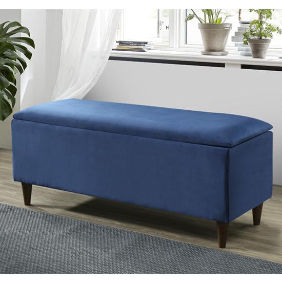 View Emstone velvet upholstered storage ottoman in blue