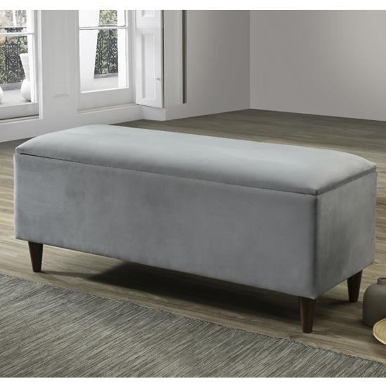 View Emstone velvet upholstered storage ottoman in grey