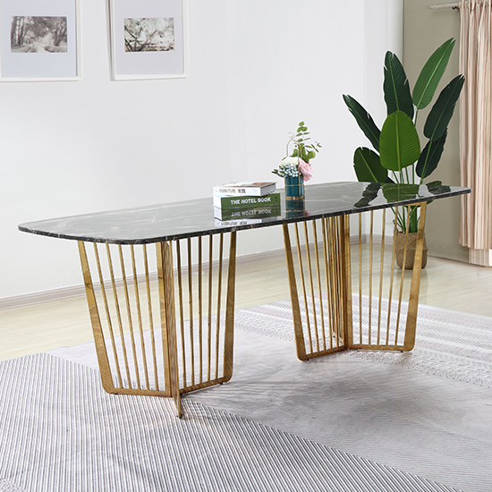 View Fastro black marble dining table with gold stainless steel legs