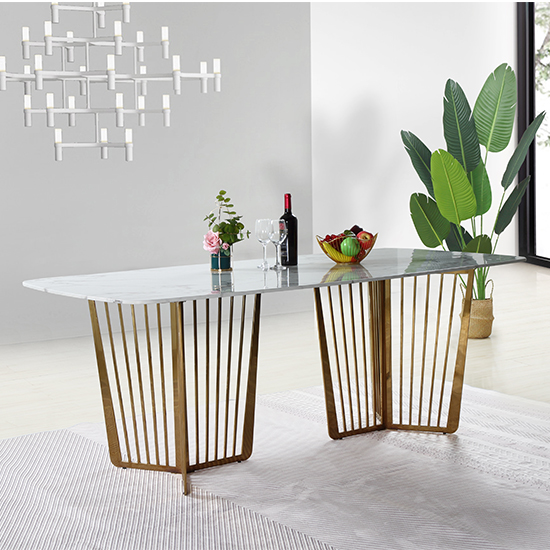 View Fastro white marble dining table with gold stainless steel legs