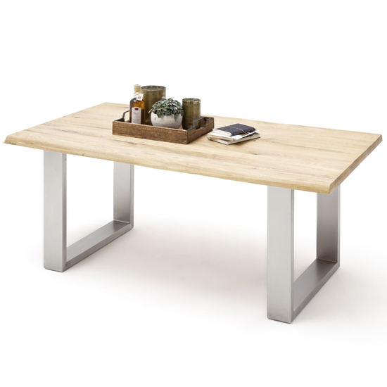 Product photograph showing Greta Medium Skid Life Edge Dining Table In Solid Oak