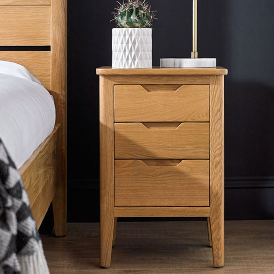 View Harriet wooden bedside cabinet in robust solid oak with 3 drawer