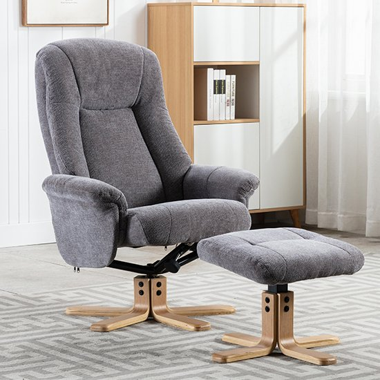 View Hatton fabric swivel recliner chair and footstool in charcoal