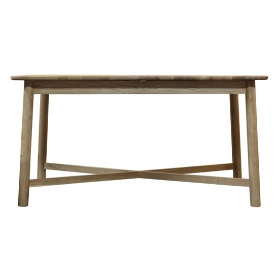 View Kingham wooden extending dining table in oak