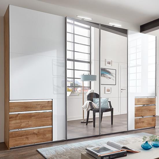 View Kraz mirrored sliding 4 door wide wardrobe in gloss white oak