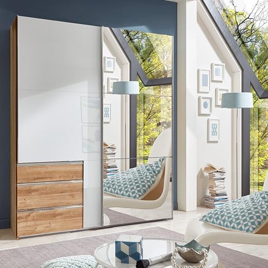 View Kraz mirrored sliding door wardrobe in gloss white planked oak