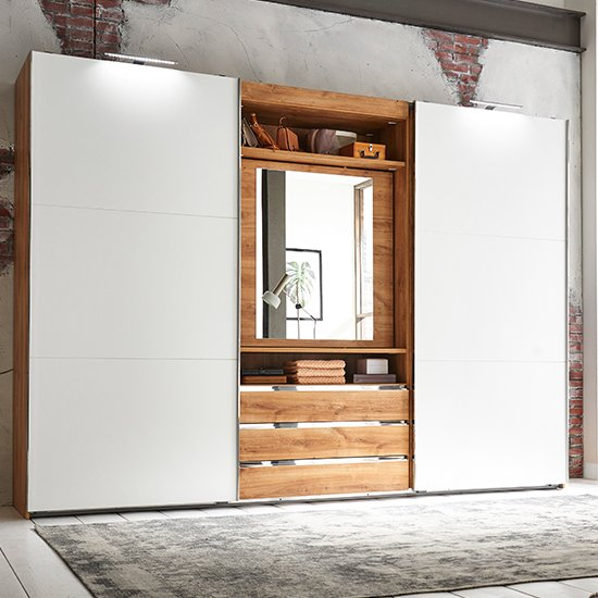 View Magic mirrored sliding wardrobe in planked oak with tv shelf