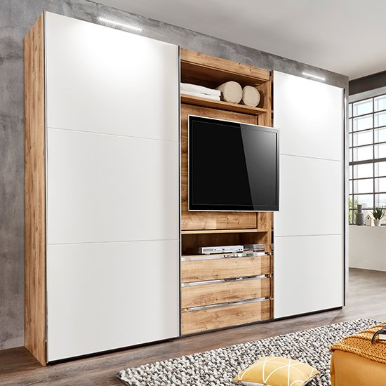 View Magic wooden sliding door wardrobe in planked oak with tv shelf