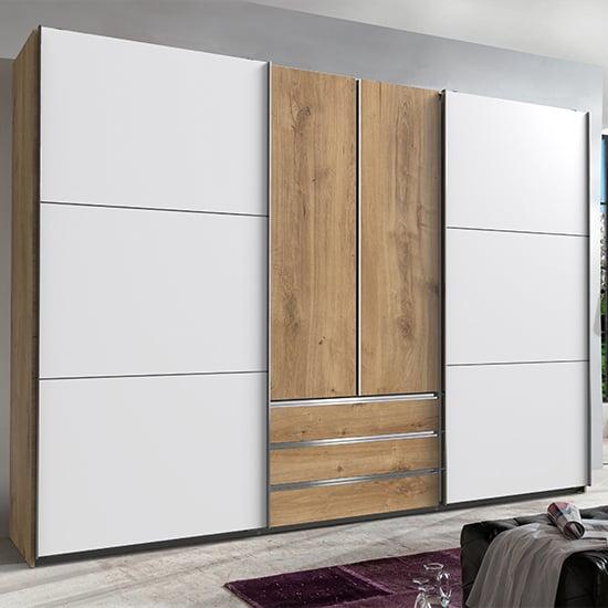 View Magic wooden sliding door wardrobe in planked oak