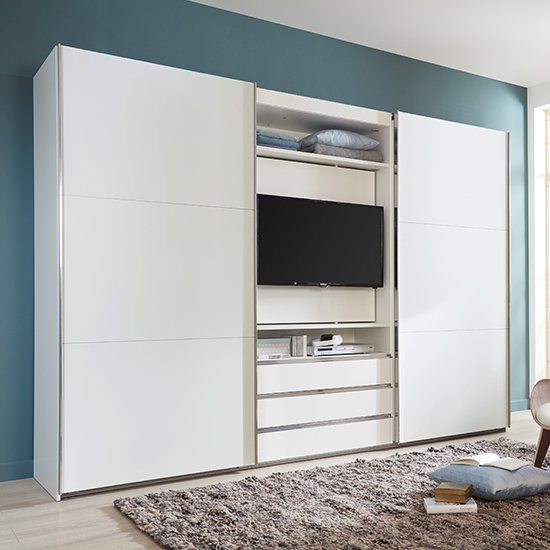 View Magic wooden sliding door wardrobe in white with tv shelf