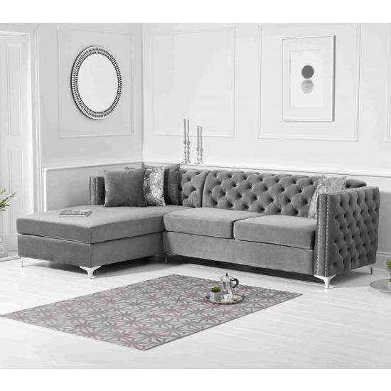 View Maxo velvet upholstered left handed chaise corner sofa in grey