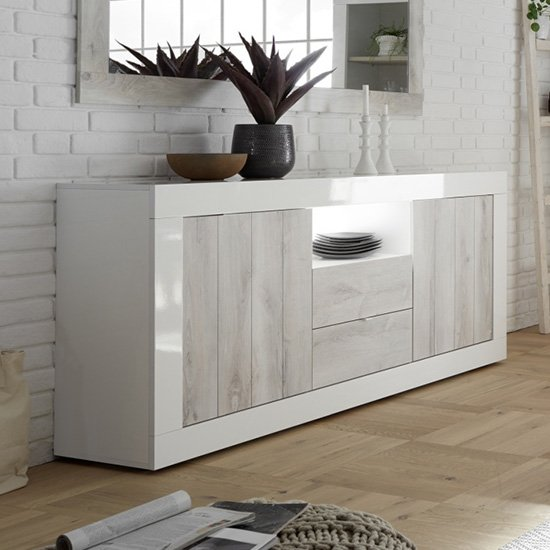 View Nitro led 2 door 2 drawer white gloss sideboard in white pine