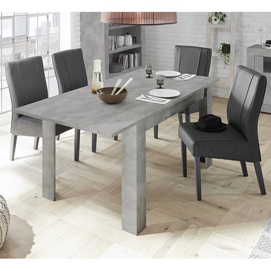 Product photograph showing Nitro Extending Cement Effect Dining Table With 4 Miko Chairs