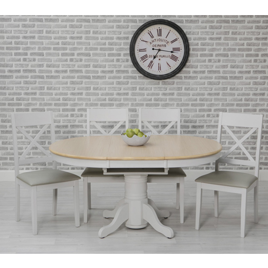 View Ohio round extending dining set with 4 padded cross back chairs