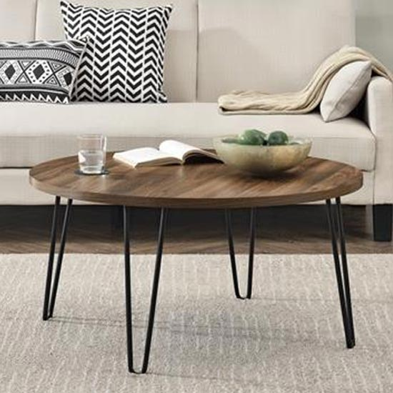 View Owen wooden round coffee table in walnut