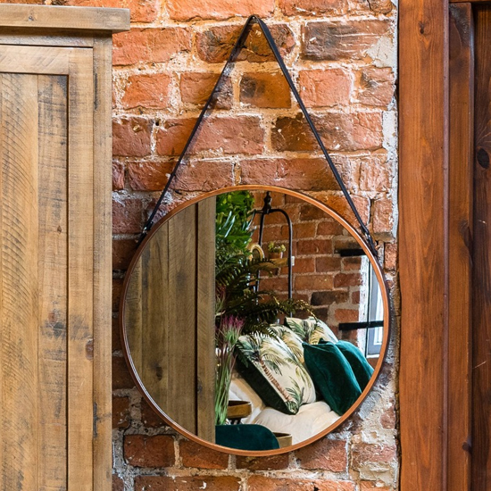 View Rumi round hanging wall mirror in copper frame with black strap
