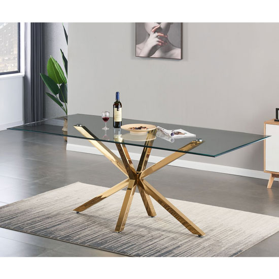 View Russo glass dining table in clear with gold steel base