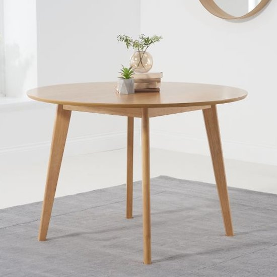 Seethes Wooden Round Dining Table In Oak