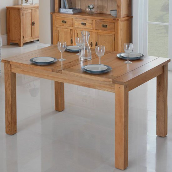View Velum wooden extending dining table in chunky solid oak