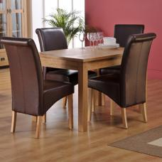 Corrick Dining Table And 4 Black Faux Leather Dining Chairs