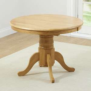 Chertan Extending Round Wooden Dining Table In Oak
