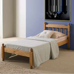 Coleton Spindle Wooden Single Bed In Waxed Pine